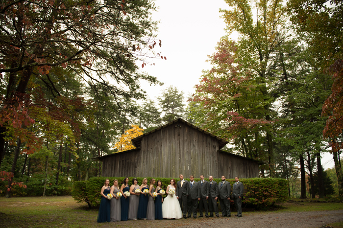 Bridal Party Posed In Front of A Barn In Tennessee