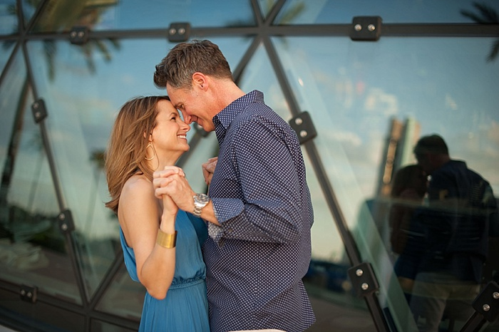 couple poses for an engagement photo in front of the Dali Museum