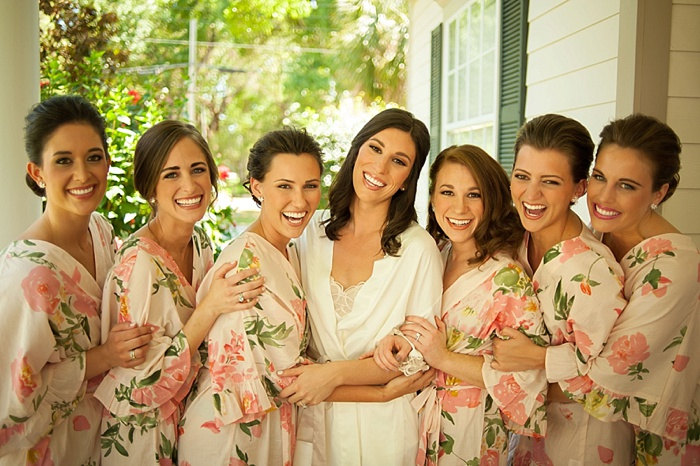 Bridesmaids wear beautiful floral robes while getting ready for Tampa Wedding