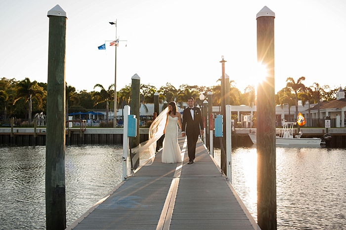 Bride and groom have their sunset photos on the water in Tampa