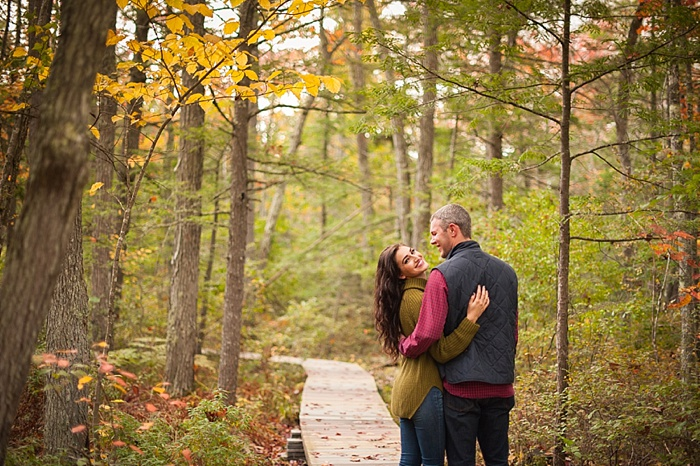 changing fall leaves in Maine are a perfect backdrop for an engagement session