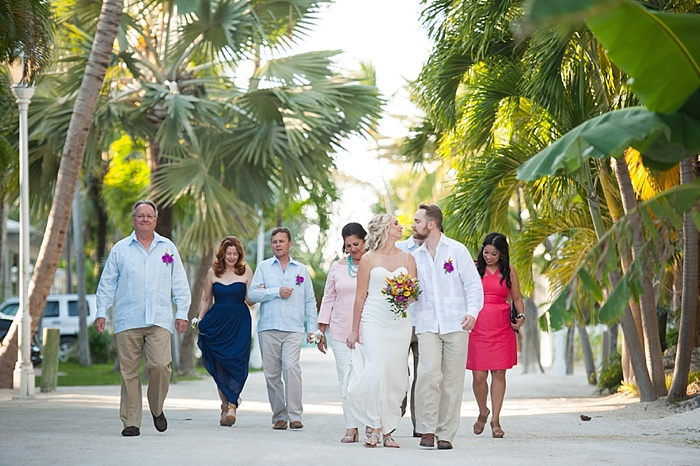 Bride and Groom walking to their elopement location at the Caribbean Resort in Islamorada Florida