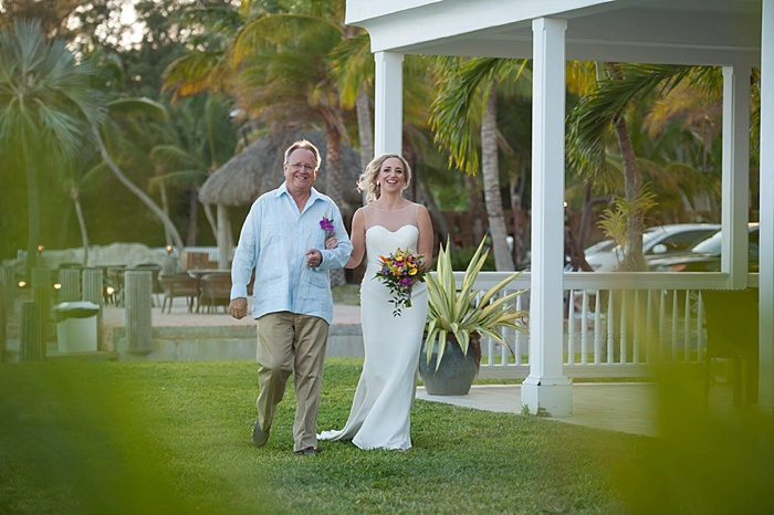 Dad walking daughter down the aisle at Caribbean resort