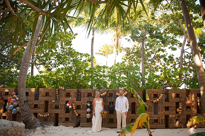 Bride and Groom pose in front of lobster traps in Florida Keys