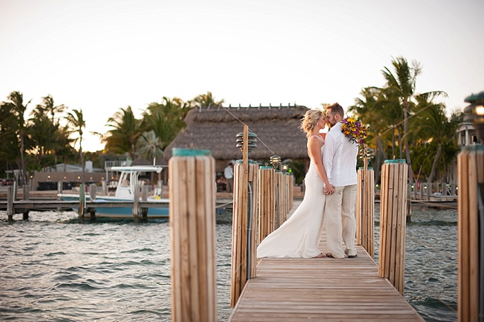 Couple Poses in the dock at Caribbean Resort because of their love for the water