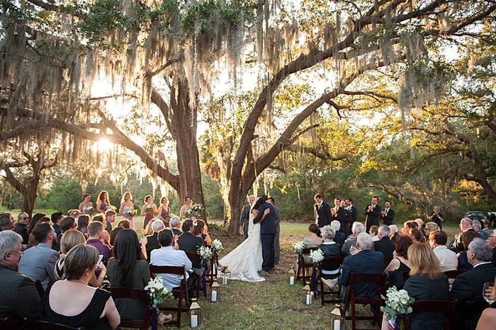 Bride and groom wed under the gray oak tree at bries grandfathers estate in Dunedin Florida