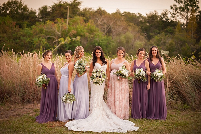 Mismatched BHLDN bridesmaids dresses in purple