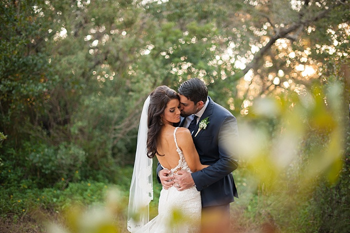 Bride wearing Martina Liana backless dress at her wedding in Dunedin Florida
