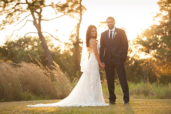 Dunedin Wedding Photographer photographs bride and groom on grandfathers property during golden hour